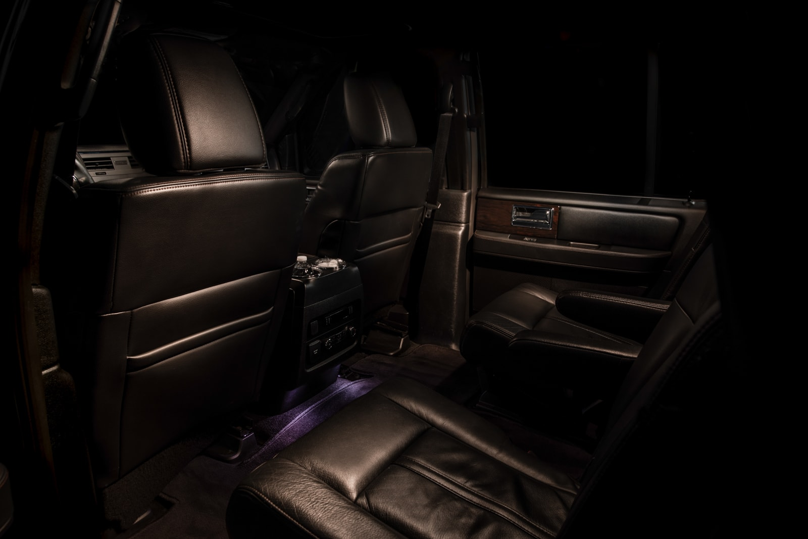Lincoln Navigator back, leather interior showing a large amount of leg room which is an important part of a luxury limo rental.