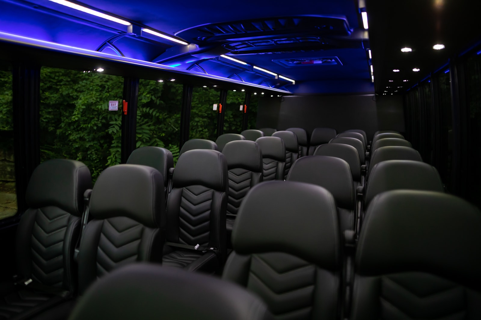 Black leather interior and custom lighting of the Grech Mini Coach, the perfect limo rental for events.