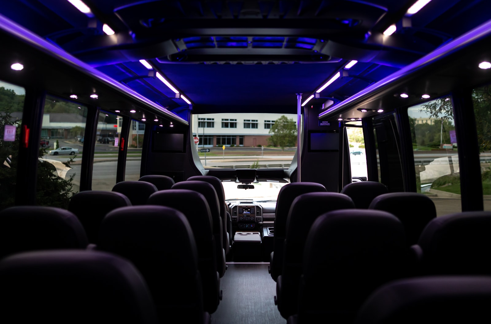 Custom front window and seating for a large group or event in the Grech Mini Coach.