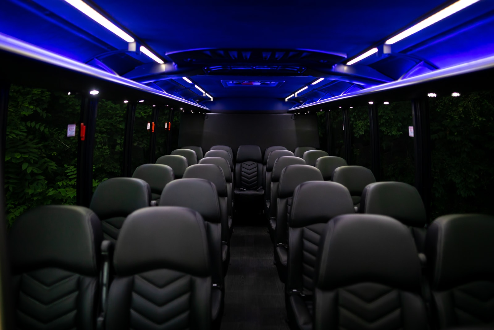 Coach interior displaying the leg room and luxury of this kc limo rental.