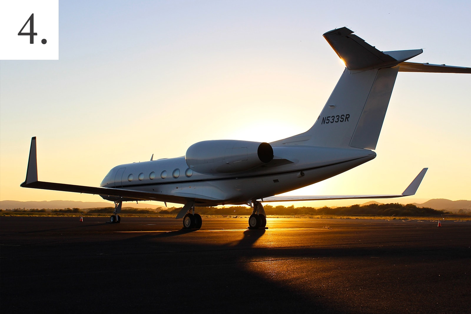 A private jet sitting on the tarmac at sunset representing safe flying options during the Coronavirus (COVID-19) pandemic.